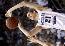 11-12mBKB vs Santa Clara Stephen Rogers 06   Stephen Rogers takes a jump shot at the BYU Men's basketball team against Santa Clara in the Marriott Center. They defeated the Broncos 95-78.  Photo by Jonathan Hardy/BYU  January 14, 2012  © BYU Photo 2011 All Rights Reserved photo@byu.edu (801) 422-7322