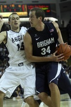 Chris Detrick  |  The Salt Lake Tribune Brigham Young Cougars forward Noah Hartsock (34) is guarded by Utah State Aggies forward Mitch Bruneel (15) during the second half of the game at the Dee Glen Smith Spectrum Friday November 11, 2011. Utah State won the game 69-62.