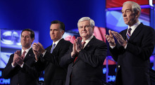 Matt Rourke  |  The Associated Press Republican presidential candidates, Rick Santorum, Mitt Romney, Newt Gingrich and Rep. Ron Paul take the stage Thursday before the start of the Republican presidential candidate debate at the North Charleston Coliseum in Charleston, S.C.
