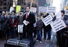 Reddit co-founder Alexis Ohanian addresses a protest in front of the building housing the New York offices of  U.S. Sens. Charles Schumer and Kristen Gilliband,  Wednesday, Jan. 18, 2012. January 18 is a date that will live in ignorance, as Wikipedia started a 24-hour blackout of its English-language articles, joining other sites in a protest of pending U.S. legislation aimed at shutting down sites that share pirated movies and other content. Reddit.com shut down its social news service for 12 hours. (AP Photo/Richard Drew)