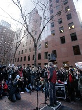 John Perry Barlow, center, co-founder of the Electronic Frontier Foundation, addresses a protest in front of the building housing the New York offices of  U.S. Sens. Charles Schumer and Kristen Gilliband, Wednesday, Jan. 18, 2012. January 18 is a date that will live in ignorance, as Wikipedia started a 24-hour blackout of its English-language articles, joining other sites in a protest of pending U.S. legislation aimed at shutting down sites that share pirated movies and other content. (AP Photo/Richard Drew)