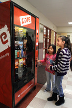 Rick Egan  | The Salt Lake Tribune   Marlen Diaz, (eft) and  Karen Canteres (right) check out a fake vending machine at Rose Park Elementary, Thursday, January 19, 2012. Intermountain Healthcare is putting the fake vending machine in some schools to help educate children about nutrition.