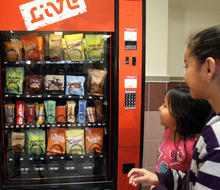 Rick Egan  | The Salt Lake Tribune   Marlen Diaz, (eft) and  Karen Canteres (right) check out a fake vending machine at Rose Park Elementary, Thursday, January 19, 2012. The machine, which talks, is designed to help educate kids about making good food choices.