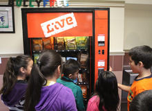Rick Egan  | The Salt Lake Tribune   Students check out a fake vending machine at Rose Park Elementary, Thursday, January 19, 2012. When kids push a button, the machine talks to them in a playful way to discourage them from eating junk food.