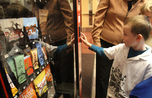 Rick Egan  | The Salt Lake Tribune   First Grader, Noah Wilson pushed a button of a fake vending machine at Rose Park Elementary, Thursday, January 19, 2012. Instead of dispensing food, the machine spits out humorous comments intended to make kids think about what they eat.