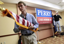 Campaign workers takes down the staging following a news conference in North Charleston, S.C., Thursday, Jan. 19, 2012, where Republican presidential candidate Texas Gov. Rick Perry announced he is suspending his campaign and endorsing Newt Gingrich.  (AP Photo/David Goldman)