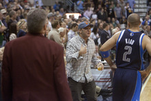 Jeremy Harmon  |  The Salt Lake Tribune  Security approaches a Jazz fan as he confronts Dallas' Jason Kidd as the Jazz host the Mavericks at EnergySolutions Arena Thursday, Jan. 19, 2012 in Salt Lake City.