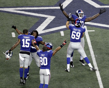 The New York Giants celebrate after defeating the Dallas Cowboys 37-34 after an NFL game Sunday, Dec. 11, 2011, in Arlington, Texas. (AP Photo/Brandon Wade)