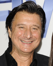 FILE - In this Sept. 26, 2011 file photo, Steve Perry, former lead singer of the rock band Journey, arrives at  a premiere screening at Skylight SoHo in New York. Perry said though the band's songs -- including the soundtrack staple
