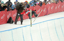 In this Feb. 5, 2011, photo, Sarah Burke, of Canada, takes a fall during the women's halfpipe finals at the freestyle skiing world championships in Park City.  Burke died Thursday morning at University Hospital in Salt Lake City, her publicist and hospital officials confirmed. The 29-year-old had been comatose since hitting her head in a fall at the superpipe at Park City Mountain Resort on Jan. 10. (AP Photo/Mark J. Terrill)