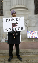 Al Hartmann     The Salt Lake Tribune  Move to Ammend protester Micahel DeSanti raises poster outside the Federal Court House Friday to speak out against the U.S. Supreme Court Citizens United ruling that allows corporations and other organizations to give unlimited amounts of cash to super PACs.