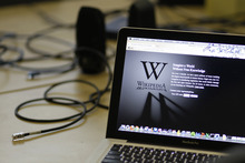A blackout landing page is displayed on a laptop computer screen inside the