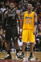 Miami Heat's LeBron James, left, and Los Angeles Lakers' Kobe Bryant look on during the third quarter of NBA basketball game in Miami on Thursday, Jan. 19, 2012. The Heat won 98-87. (AP Photo/El Nuevo Herald, David Santiago)  MAGS OUT