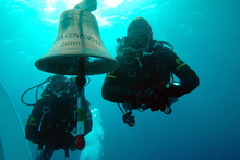 In this undated underwater photo released by Carabinieri (Italian paramilitary police) Friday, Jan. 20, 2012 two Carabinieri scuba divers swim next to the Costa Concordia cruise ship's bell, off the tiny Giglio island, Italy. The $450 million Costa Concordia was carrying more than 4,200 passengers and crew when it slammed into well-marked rocks off the island of Giglio after the captain made an unauthorized diversion from his programmed route. The ship then keeled over on its side. (AP Photo/Carabinieri)