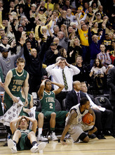 William & Mary players including Quinn McDowell (20) and Julian Boatner (2) react as Virginia Commonwealth guard Troy Daniels (30) celebrates a play during an NCAA college basketball game, Thursday, Jan. 19, 2012, in Richmond, Va. Virginia Commonwealth won 69-68 in overtime. (AP Photo/Richmond Times-Dispatch, Eva Russo)