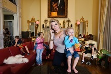 Jacqueline Siegel, shown here with many of her children, is one of the subjects of the documentary
