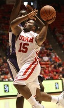 Rick Egan  | The Salt Lake Tribune   Utah guard Josh Watkins goes to the hoop in a game against Washington at the Huntsman Center in Salt Lake City, Saturday, Jan. 7, 2012.