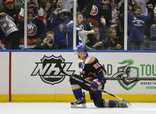 Fans cheer as New York Islanders' John Tavares (91) celebrates his goal against Carolina Hurricanes goalie Cam Ward in overtime of an NHL hockey game on Saturday, Jan. 21, 2012, in Uniondale, N.Y. Tavares scored two goals during the Islanders 2-1 win. (AP Photo/Kathy Kmonicek)