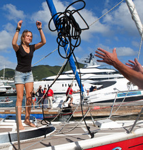 Dutch sailor Laura Dekker throws a rope as she docks her boat in Simpson Bay Marina in St. Maarten, Saturday Jan. 21, 2012.  Dekker ended a yearlong voyage aboard her sailboat named