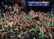 Notre Dame students rush the court following their victory over Syracuse of an NCAA college basketball game Syracuse, Saturday Jan. 21, 2012, in South Bend, Ind. Notre Dame upset No. 1 Syracuse 67-58 and handed the Orange their first loss after 20 straight victories. (AP Photo/Joe Raymond)