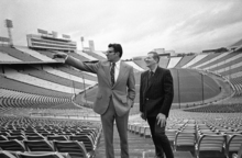 Penn State football coach Joe Paterno, left, is shown with Cliff Speegle, an official of the Southwest Conference, as they toured the Cotton Bowl in Dallas on Dec. 14, 1971. Paterno was in town to look over the facilities in preparation for the New York?s Day meeting of Penn State and the University of Texas. (AP Photo/Ferd Kaufman)
