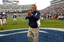 Penn State coach Joe Paterno walks the field before Penn State's 37-13 win over Michigan State, Saturday, Nov. 20, 2004, in State College, Pa. (AP Photo/Carolyn Kaster)