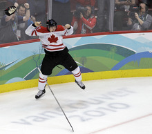 ADVANCE FOR WEEKEND EDITIONS, JAN. 21-22 - FILE - In this Feb. 28, 2010, file photo, Canada's Sidney Crosby (87) leaps in the air after making the game-winning goal in the overtime period of a men's gold medal ice hockey game against USA at the Vancouver 2010 Olympics in Vancouver, British Columbia. Two years after Crosby's dramatic overtime goal on the final day of the Vancouver Olympics, Sid the Kid has become Sid the Ghost, a recurrence of concussion-like symptoms turning the 24-year-old face of hockey into a cautionary tale on inherent dangers of the game. (AP Photo/Chris O'Meara, File)