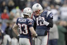 New England Patriots quarterback Tom Brady (12) talks with wide receiver Wes Welker (83) before the AFC Championship NFL football game against the Baltimore Ravens Sunday, Jan. 22, 2012, in Foxborough, Mass.  (AP Photo/Matt Slocum)