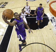 Sacramento Kings' Marcus Thornton (23) drives to the basket during the first quarter of an NBA basketball game against the San Antonio Spurs, Friday, Jan. 20, 2012, in San Antonio. (AP Photo/Eric Gay)