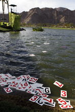 Numbers float in the lake on the 18th hole after a wind storm blew the scoreboard into the water during the third round of the Humana Challenge golf tournament on the Palmer Private course at PGA West in La Quinta, Calif., Saturday, Jan. 21, 2012. (AP Photo/Chris Carlson)