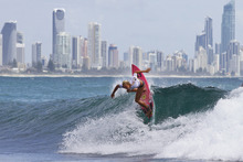 In this photo provided by the Association of Surfing Professionals, Ellie-Jean Coffey, of Australia, competes in the Billabong World Junior Championship Gold Coast surfing competition in Burleigh Heads, Australia, on Saturday, Jan. 22, 2012. (AP Photo/Association of Surfing Professionals, Matt Dunbar)