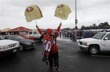 A San Francisco 49ers fan is shown outside of Candlestick Park before the NFC Championship NFL football game against the New York Giants Sunday, Jan. 22, 2012, in San Francisco. (AP Photo/David J. Phillip)