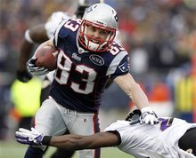 Baltimore Ravens cornerback Lardarius Webb (21) attempts to stop New England Patriots wide receiver Wes Welker (83) during the first half of the AFC Championship NFL football game  Sunday, Jan. 22, 2012, in Foxborough, Mass.  (AP Photo/Winslow Townson)