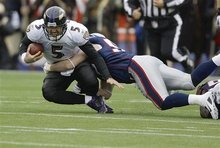 New England Patriots outside linebacker Dane Fletcher (52) tackles Baltimore Ravens quarterback Joe Flacco (5) during the first half of the AFC Championship NFL football game  Sunday, Jan. 22, 2012, in Foxborough, Mass.  (AP Photo/Matt Slocum)