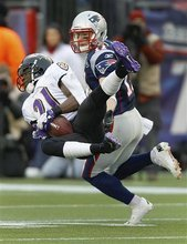 Baltimore Ravens cornerback Lardarius Webb (21) intercepts a pass intended for New England Patriots wide receiver Julian Edelman (11) during the first half of the AFC Championship NFL football game  Sunday, Jan. 22, 2012, in Foxborough, Mass.  (AP Photo/Charles Krupa)