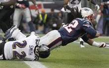 New England Patriots running back BenJarvus Green-Ellis (42) drags Baltimore Ravens defensive back Jimmy Smith (22) into the end zone for a touchdown during the first half of the AFC Championship NFL football game  Sunday, Jan. 22, 2012, in Foxborough, Mass.  (AP Photo/Elise Amendola)