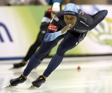 USA's Shani Davis skates to a first place finish in the men's 1000m at the World Cup speedskating event Saturday, Jan. 21, 2012, in Kearns, Utah. (AP Photo/George Frey)