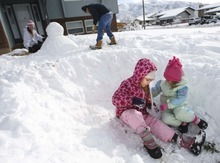 Leah Hogsten  |  The Salt Lake Tribune The Criswell family enjoyed Ogden's heavy snowfall Sunday morning after shoveling their driveway. Daughters Paisley, 8, and Rylee, 4, play in their semicircle fort while their parents, Ryan and Nicole, build a snowman. Heavy snowfall within the past 24 hours has created a high danger of avalanches all along the Wasatch Mountains Sunday.