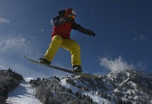 Leah Hogsten  |  The Salt Lake Tribune A snowboarder hucks into the air at Snowbasin Ski Resort Sunday while enjoying blue skies and the 22 inches of new snow on the runs. Heavy snowfall within the past 24 hours has created a high danger of avalanches all along the Wasatch Mountains