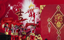 Chinese dancers perform on a stage at a temple fair in Ditan Park during the first day of the Chinese Lunar New Year in Beijing, China, Monday, Jan. 23, 2012. (AP Photo/Andy Wong)