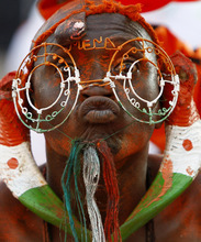 A Niger fan wearing gazelle horns on his ears reacts during their African Cup of Nations Group C soccer match Gabon against Niger at the Stade De L'Amitie in Libreville, Gabon, Monday, Jan. 23, 2012. (AP Photo/Francois Mori)