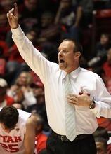Rick Egan  | The Salt Lake Tribune   Utah Utes head coach Larry krystkowiak shouts directions to his players, in Basketball action Utah vs. The Washington Huskies, at the Huntsman Center, Saturday, January 7, 2012.