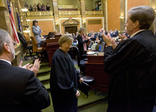 Al Hartmann  |  The Salt Lake Tribune Utah Supreme Court Chief Justice Christine Durham, center, leaves the House of Representatives after giving State of Judiciary speech to members of the 2012 Legislature on Monday, Jan. 23. She announced she will be stepping down as chief justice.  Justice Matthew Durrant, right, will replace her as chief justice.