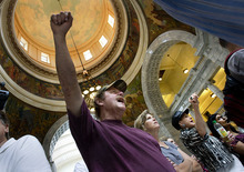 Scott Sommerdorf  |  Tribune File Photo              Protesters angry about the Legislature's redistricting plans, chant