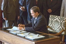 PAUL FRAUGHTON  |  Tribune file photo  With religious, community, business and government leaders behind him, Utah Gov. Gary Herbert last year signs into law immigration bills passed in the 2011 Legislature. This year's session convenes Monday.