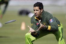 Pakistan's Umar Gul warms up during a cricket practice session at the Sheikh Zayed Cricket Stadium in Abu Dhabi, United Arab Emirates, Tuesday, Jan. 24, 2012. Pakistan are due to play England in their second cricket test match in starting Abu Dhabi on Wednesday. (AP Photo/Hassan Ammar)