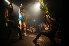 In this Saturday, Jan. 7, 2012 photo, female impersonator Arisa and dancers perform on stage at a gay party in Tel Aviv, Israel. Thanks to a balmy climate, a vibrant nightlife and a creative, government-backed branding campaign, Tel Aviv has become one of the world's top gay tourist destinations.  (AP Photo/Maya Hasson)