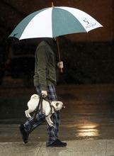 Justin Bonderach carries his dog