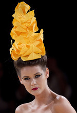 A model wears a creation by Neon during Sao Paulo Fashion Week in Sao Paulo, Brazil, Tuesday Jan. 24, 2012. (AP Photo/Andre Penner)