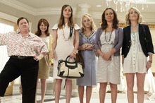 When Lillian (Maya Rudolph, second from right) gets engaged, she gathers her maid of honor Annie (Kristen Wiig, far right) and her bridesmaids (from left, Melissa McCarthy, Ellie Kemper, Rose Byrne and Wendi McLendon-Covey) in the comedy